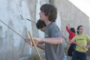 Kids volunteer to clean up the graffiti